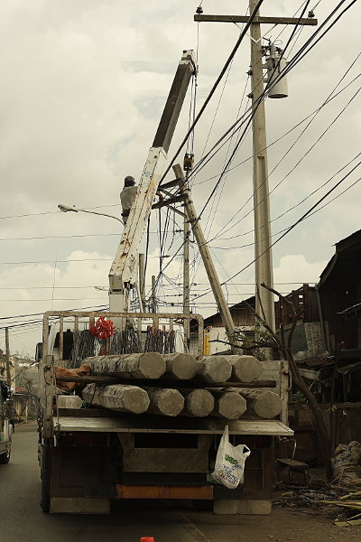 Repairing power lines after Typhoon Cosme